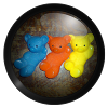 a picture of 3 plastic bears, blue, orange, and yellow